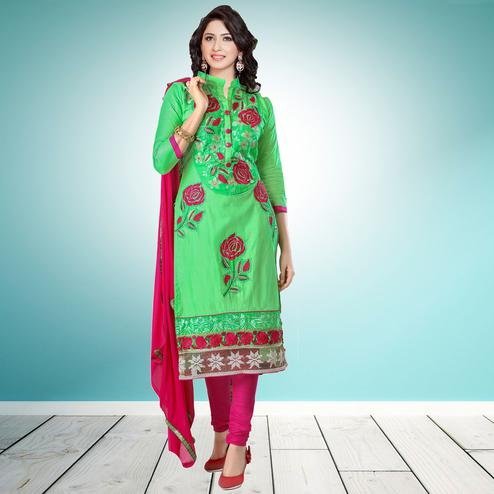 Gleaming Green Colored Partywear Embroidered Cambric Cotton Dress Material
