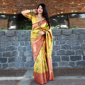 Pleasant Yellow Colored Party Wear Printed Banarasi Patola Silk Saree