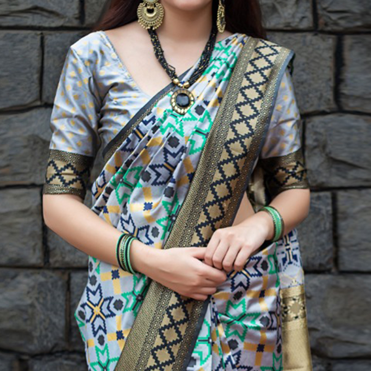 Sensational Grey Colored Party Wear Printed Banarasi Patola Silk Saree
