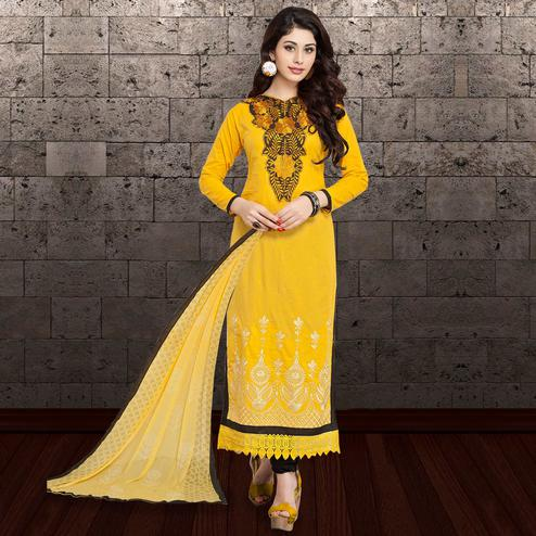 Impressive Yellow Colored Partywear Embroidered Cambric Cotton Dress Material