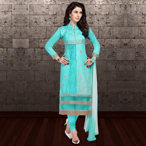 Gleaming Turquoise Blue Colored Partywear Embroidered Cambric Cotton Dress Material