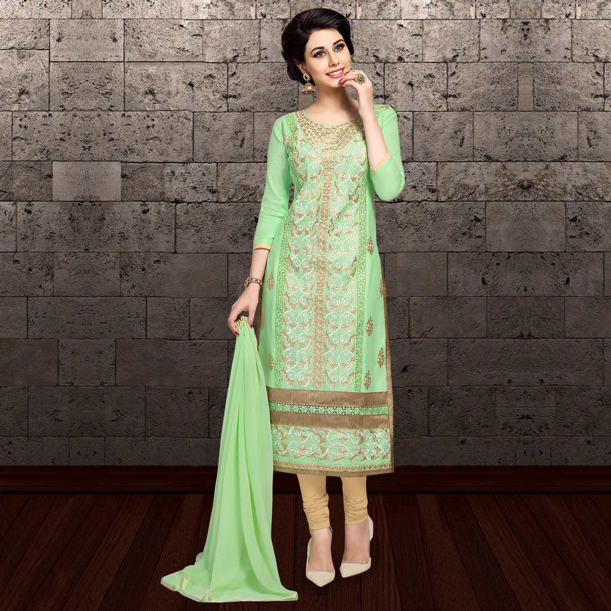 Refreshing Light Green Colored Partywear Embroidered Cambric Cotton Dress Material