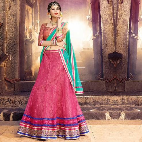 Adorable Pink Colored Party Wear Embroidered Net Lehenga Choli