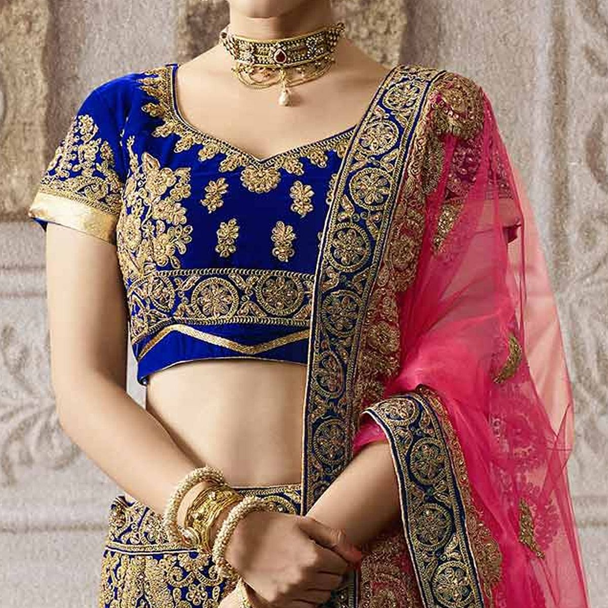 Prominent Royal Blue Colored Wedding Wear Embroidered Velvet Lehenga Choli