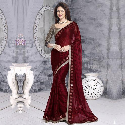 Surpassing Maroon Colored Party Wear Printed Georgette Saree