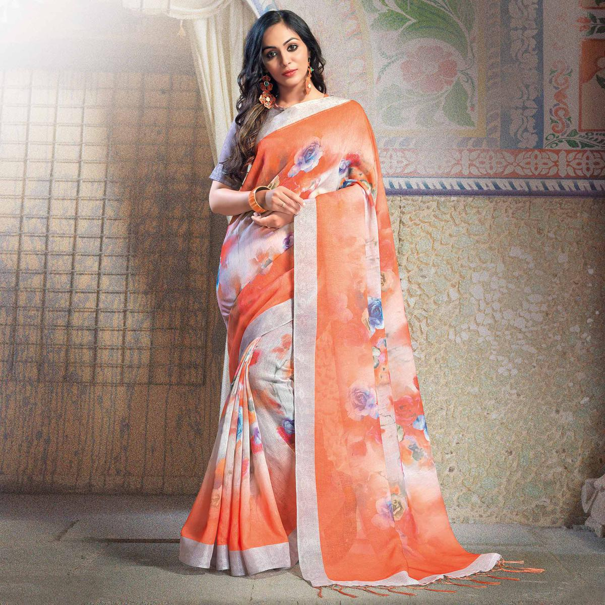 Attractive Orange Colored Casual Printed Linen Saree