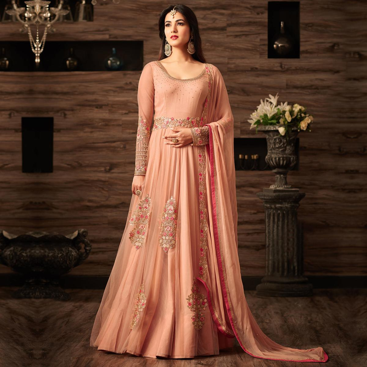 Starring Peach Colored Party Wear Embroidered Net Anarkali Suit