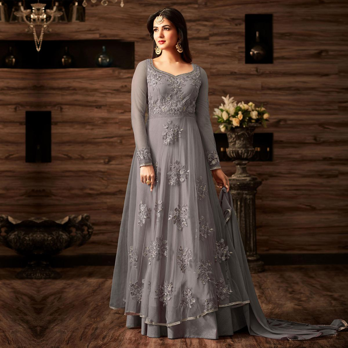 Gorgeous Grey Colored Partywear Embroidered Net Anarkali Suit