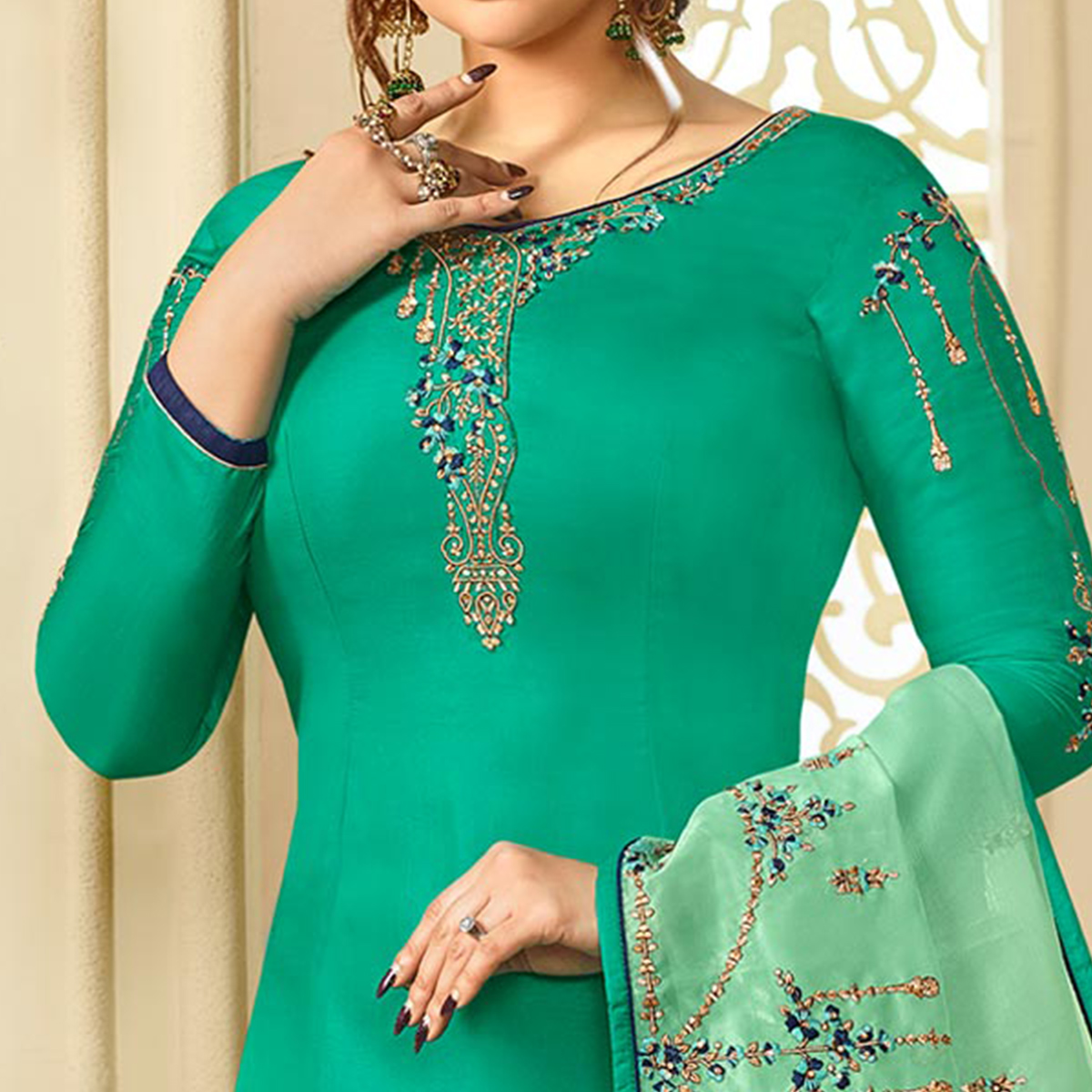 Amazing Turquoise Green Colored Partywear Embroidered Georgette Satin Suit