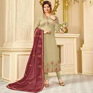 Gleaming Beige Colored Partywear Embroidered Georgette Satin Suit