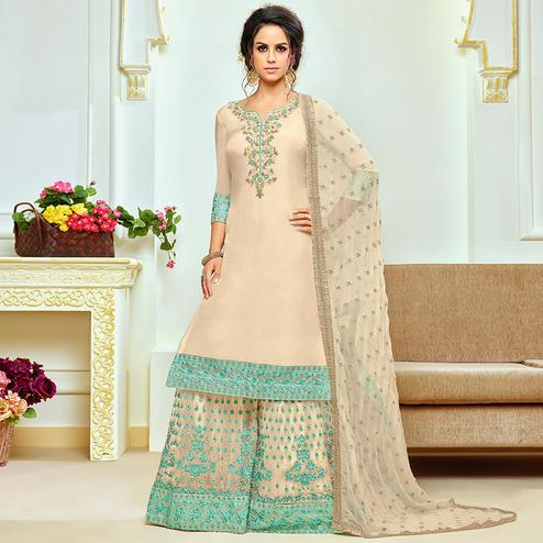 Fantastic Off-White Colored Partywear Embroidered Uppada Silk Palazzo Suit