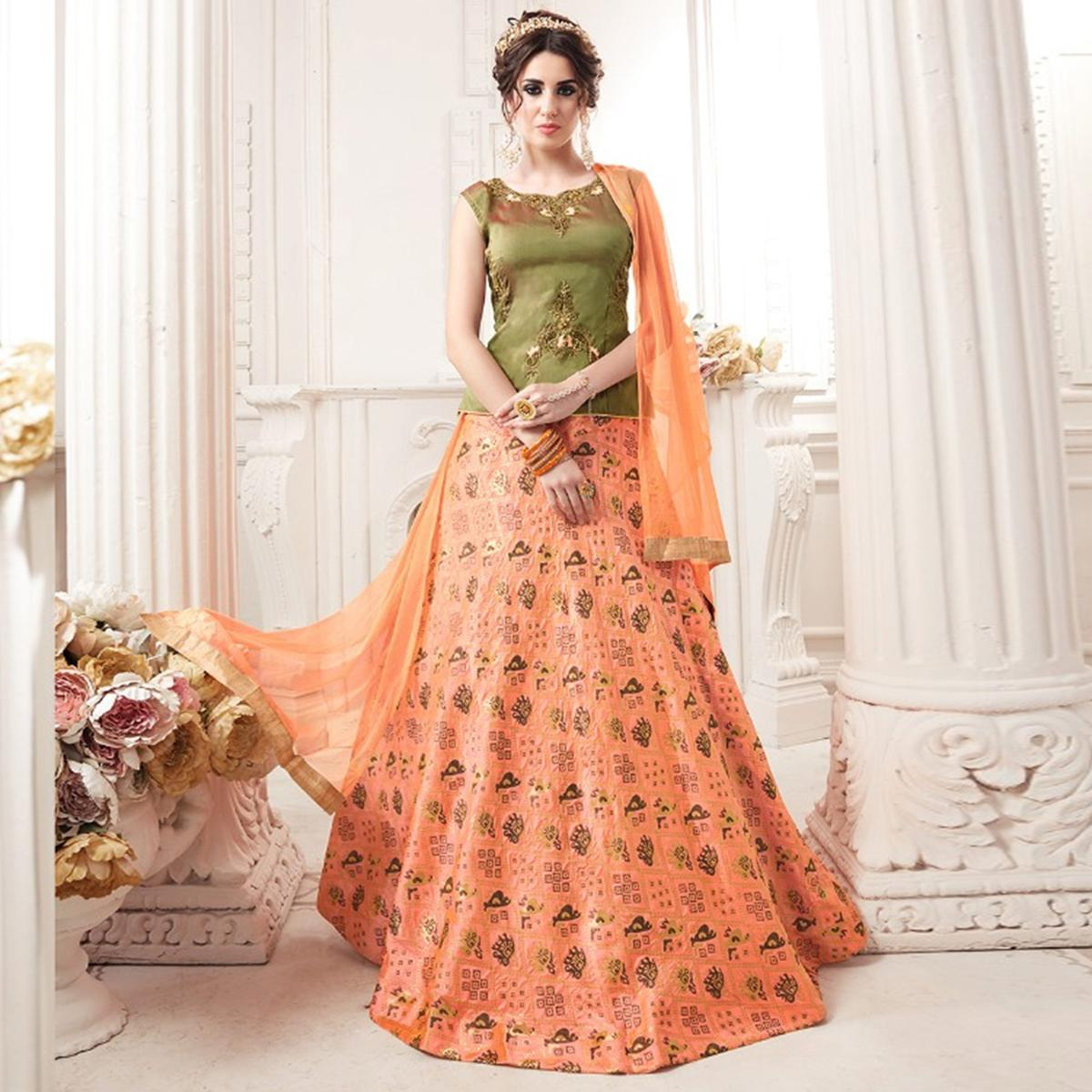 Exceptional Green-Peach Colored Partywear Embroidered Jacquard Silk Lehenga Choli