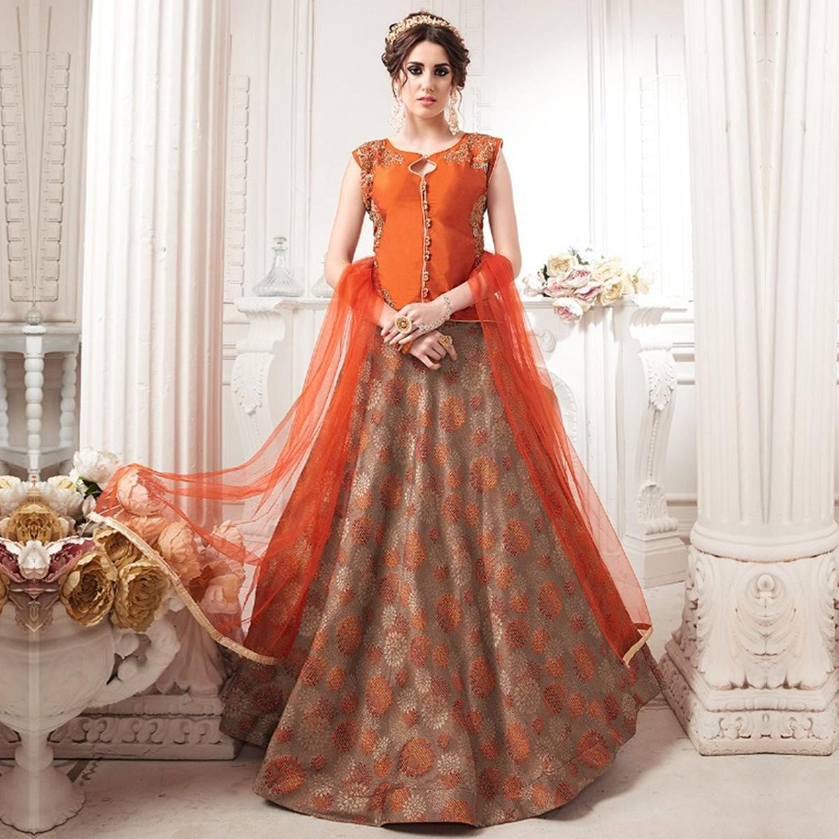 Gorgeous Orange-Brown Colored Partywear Embroidered Jacquard Silk Lehenga Choli