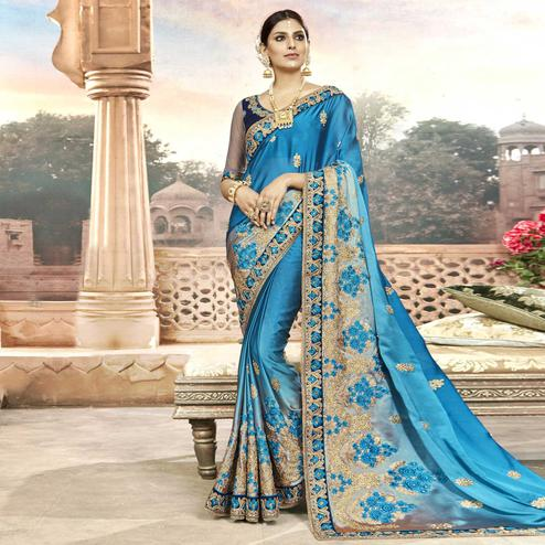 Entrancing Blue Colored Partywear Embroidered Georgette Saree