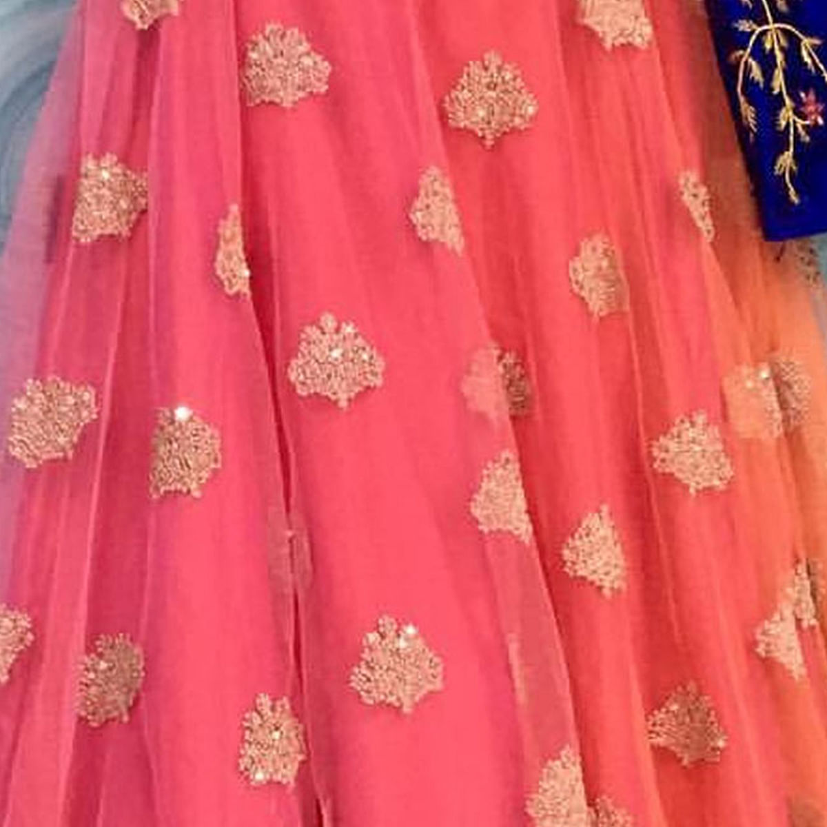 Ravishing Blue-Peach Designer Embroidered Net Lehenga Choli