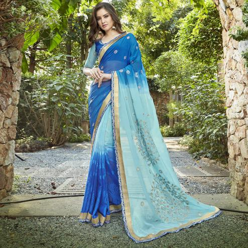 Intricate Blue Colored Partywear Embroidered Georgette-Jacquard Half-Half Saree