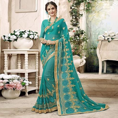 Sophisticated Light Blue Colored Partywear Embroidered Faux Georgette Saree