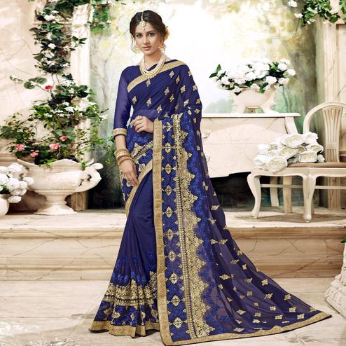 Demanding Navy Blue Colored Partywear Embroidered Faux Georgette Saree