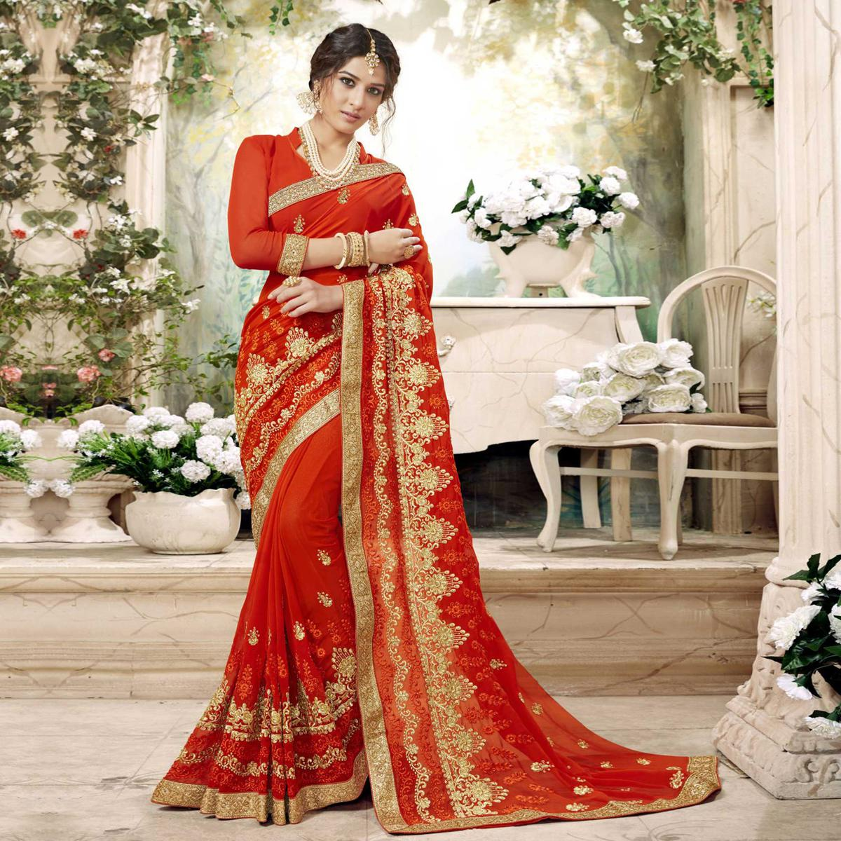 Pleasant Orange Colored Partywear Embroidered Faux Georgette Saree