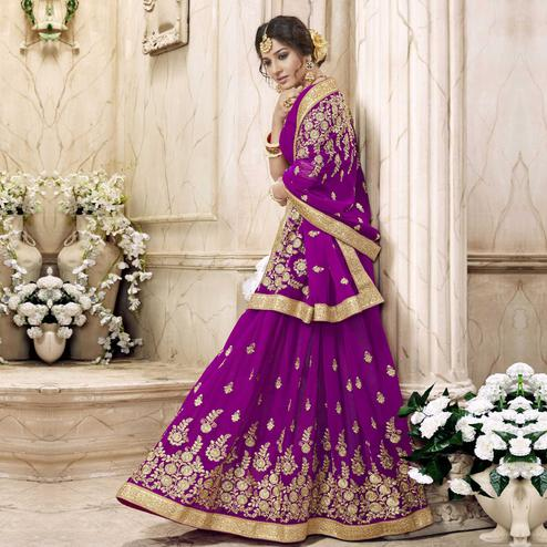 Unique Violet Colored Partywear Embroidered Faux Georgette Saree