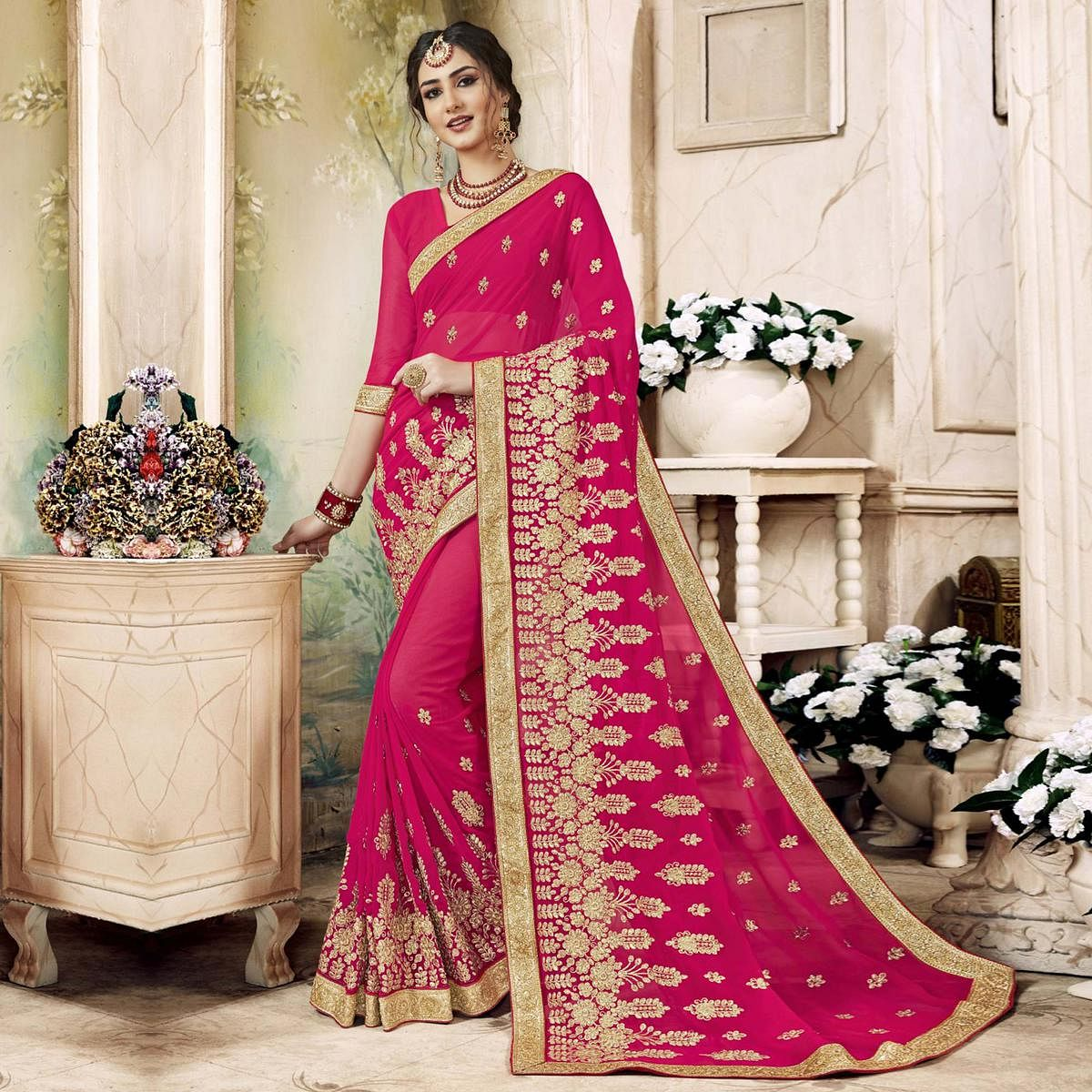Elegant Pink Colored Partywear Embroidered Faux Georgette Saree