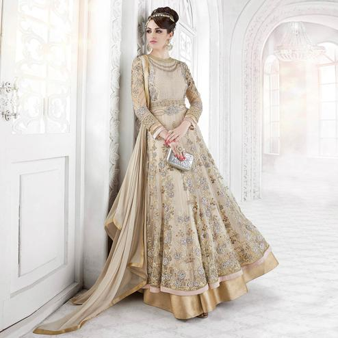 Glorious Beige Colored Party Wear Embroidered Net Anarkali Suit