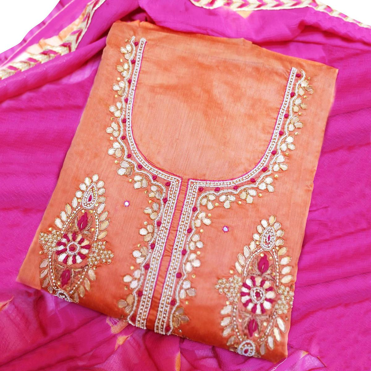 Marvellous Orange Colored Partywear Embroidered Modal Material