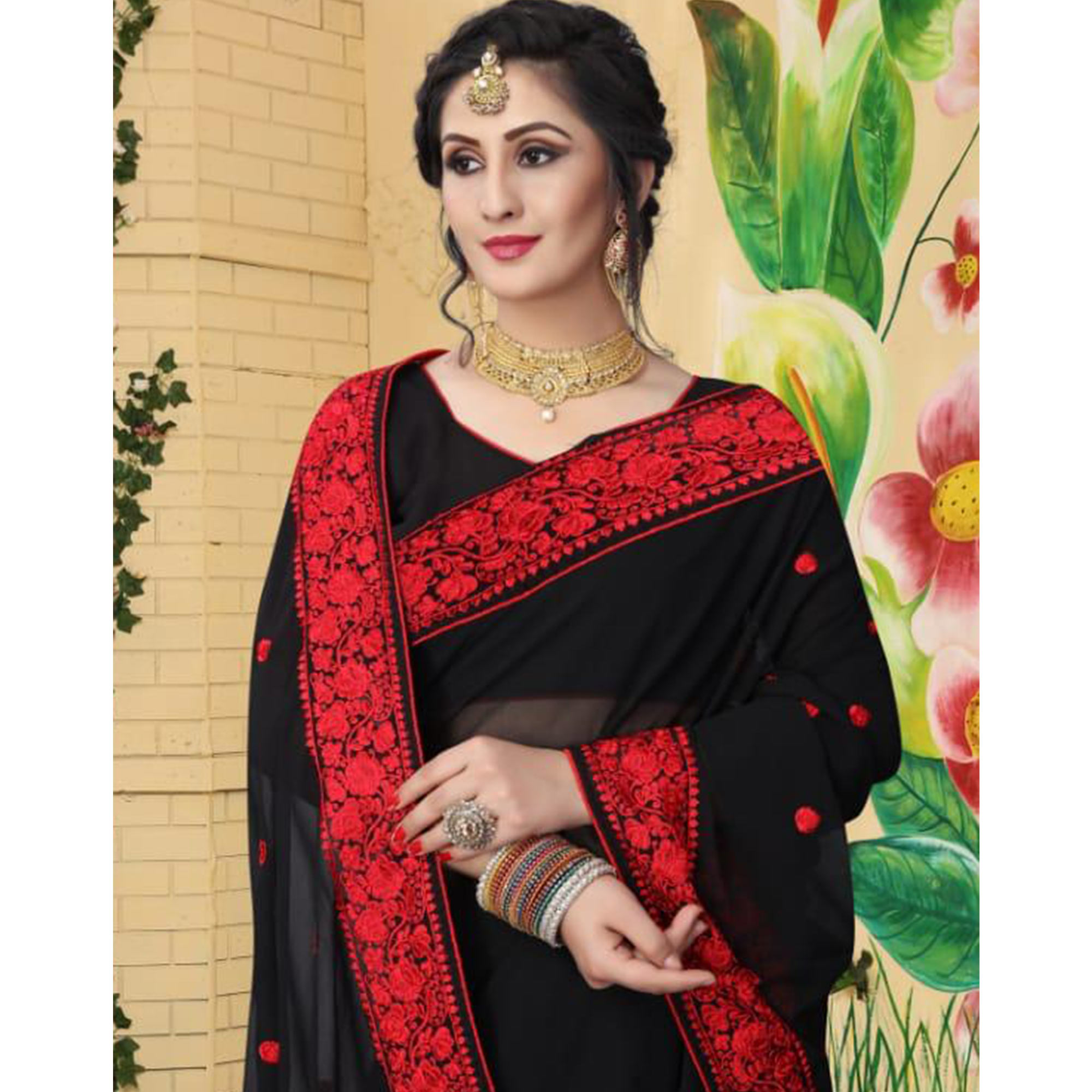 Desiring Black Colored Partywear Embroidered Georgette Saree