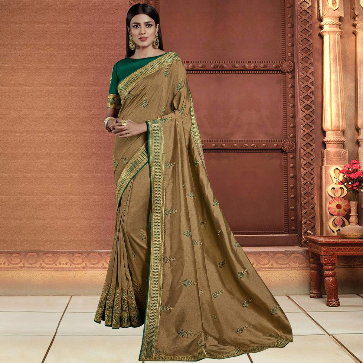 Marvellous Chiku Colored Partywear Embroidered Silk Saree