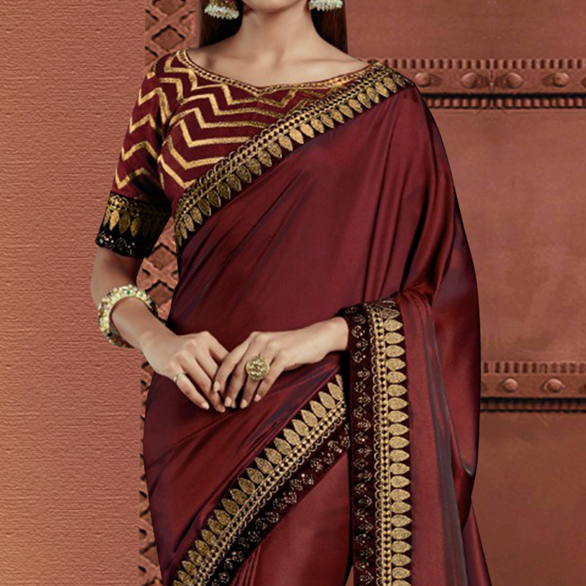 Stunning Maroon Colored Partywear Embroidered Silk Saree
