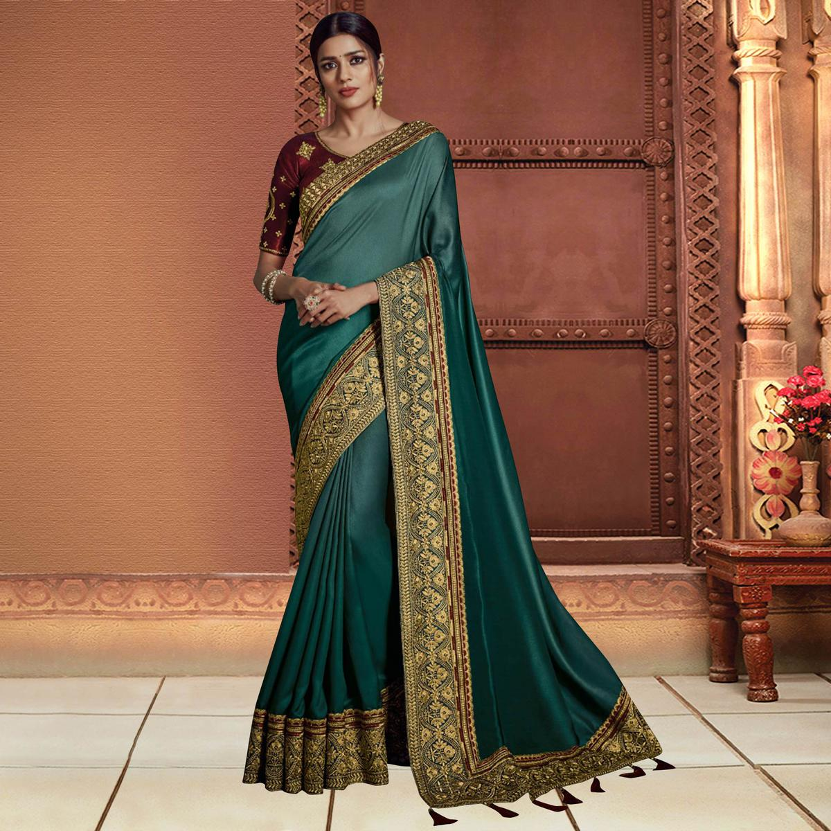 Exceptional Teal Blue Colored Partywear Embroidered Silk Saree