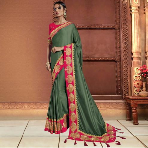 Flamboyant Olive Green Colored Partywear Embroidered Satin Silk Saree