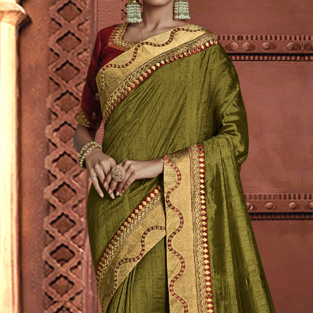 Gorgeous Mehendi Green Colored Partywear Embroidered Silk Saree