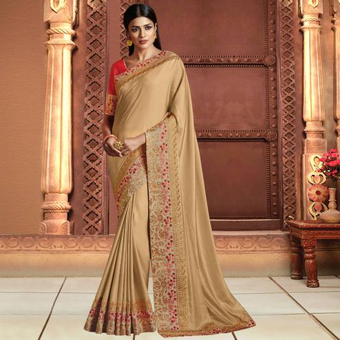 Amazing Beige Colored Partywear Embroidered Satin Silk Saree