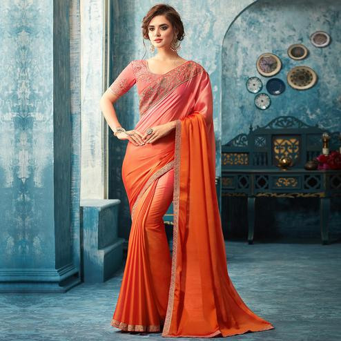 Desirable Orange-Pink Colored Partywear Embroidered Georgette Silk Saree