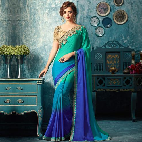 Pretty Blue Colored Partywear Embroidered Chiffon Silk Saree
