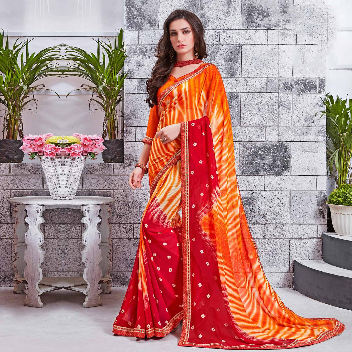 Dashing Orange Printed Georgette Saree