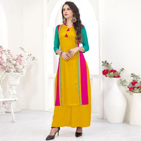 Jazzy Yellow Colored Partywear Embroidered Rayon Kurti