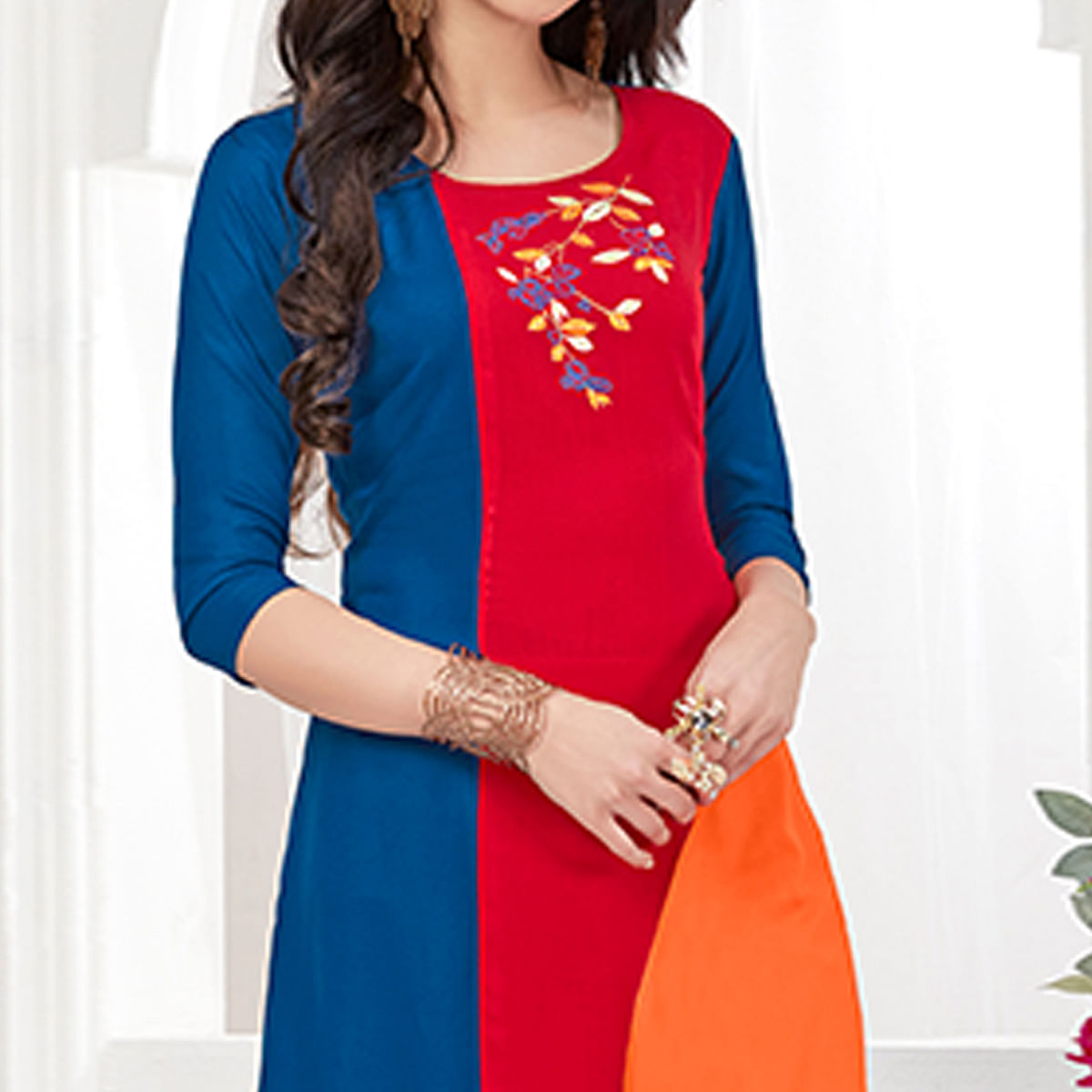 Prominent Royal Blue-Red Colored Partywear Embroidered Rayon Kurti