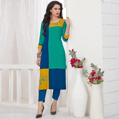 Capricious Turquoise Green-Blue Colored Partywear Embroidered Rayon Kurti