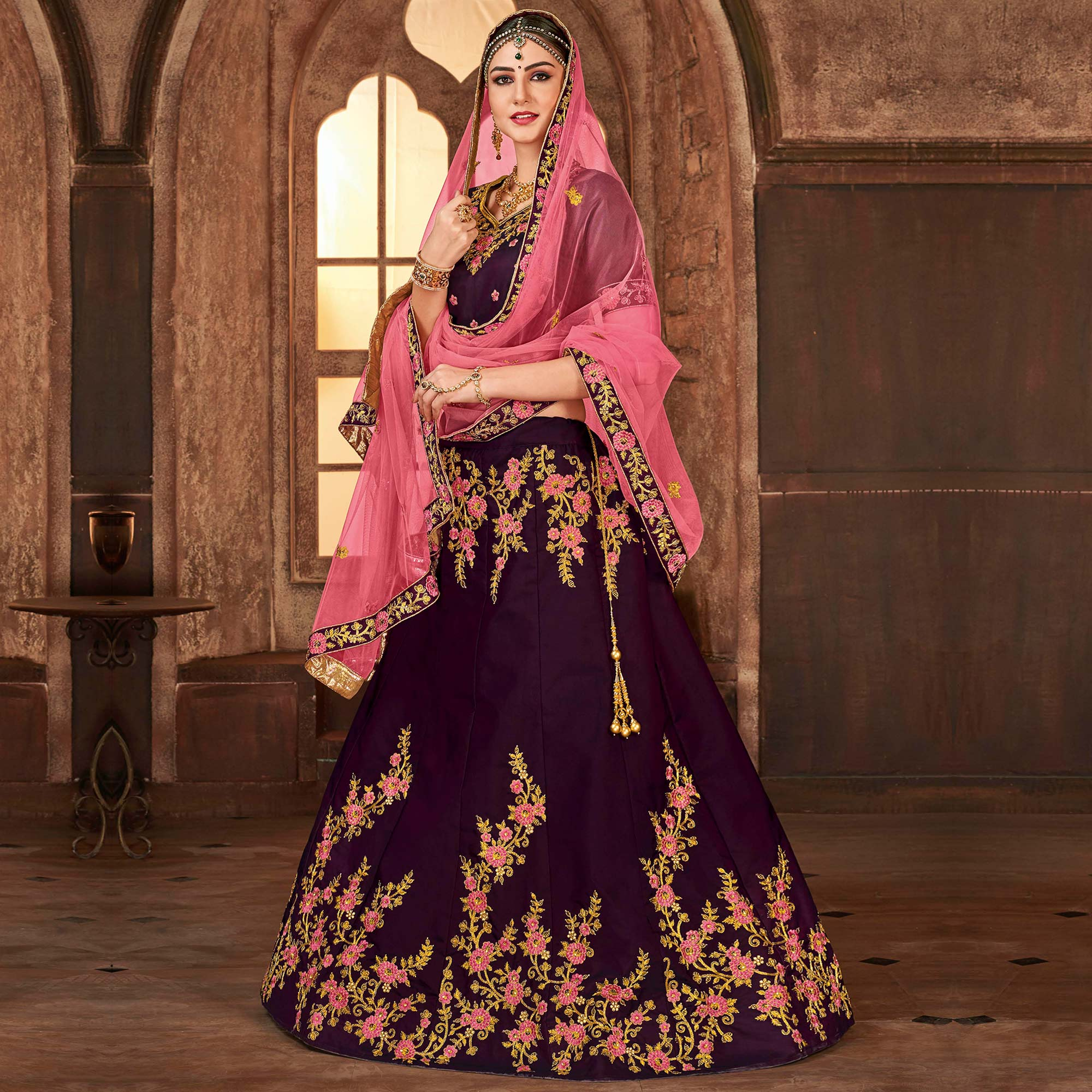 Demanding Wine Colored Partywear Embroidered Satin Silk Lehenga Choli