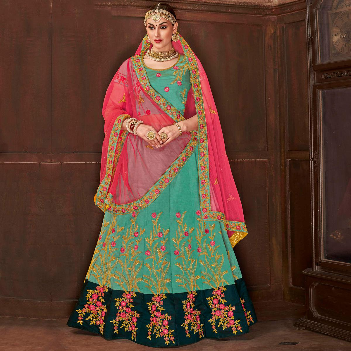 Sensational Turquoise Green Colored Partywear Embroidered Satin Silk Lehenga Choli