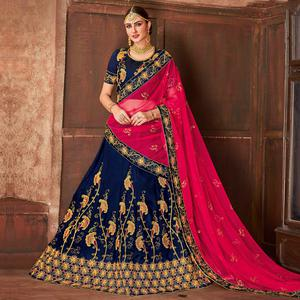 Flattering Blue Colored Partywear Embroidered Satin Silk Lehenga Choli