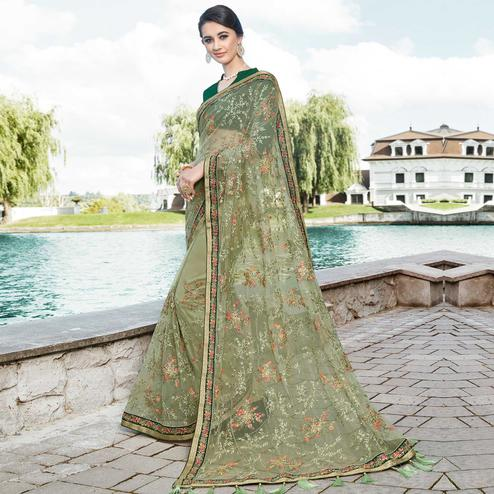 Pretty Olive Green Colored Partywear Embroidered Net Saree