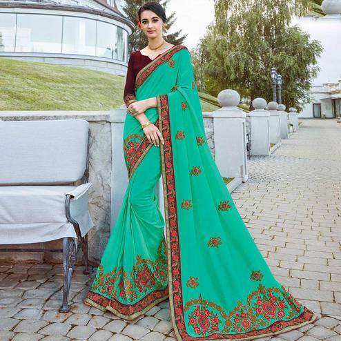 Blooming Turquoise Green Colored Partywear Embroidered Georgette Saree