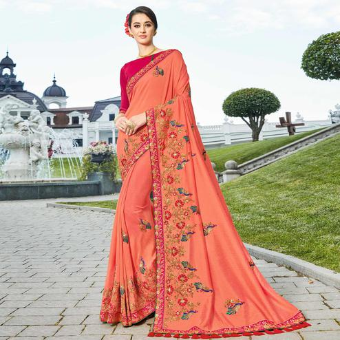 Mesmerising Peach Colored Partywear Embroidered Silk Saree