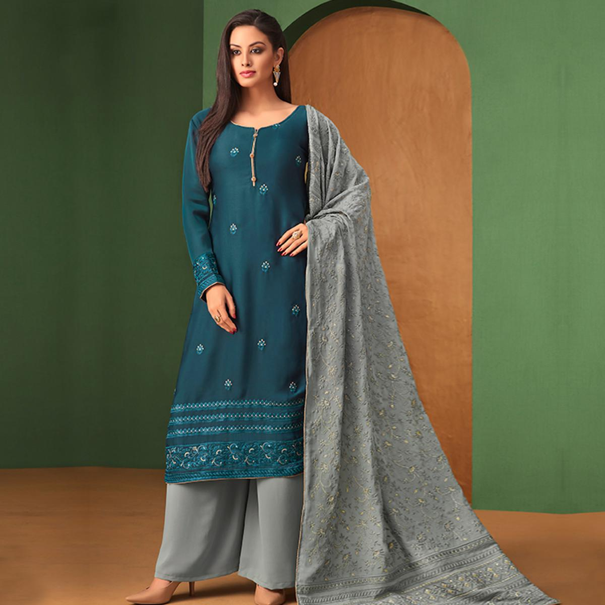 Exotic Blue Colored Partywear Embroidered Palazzo Suit