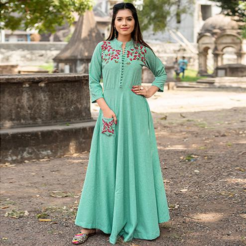 Flamboyant Turquoise Green Colored Partywear Embroidered Cotton Kurti
