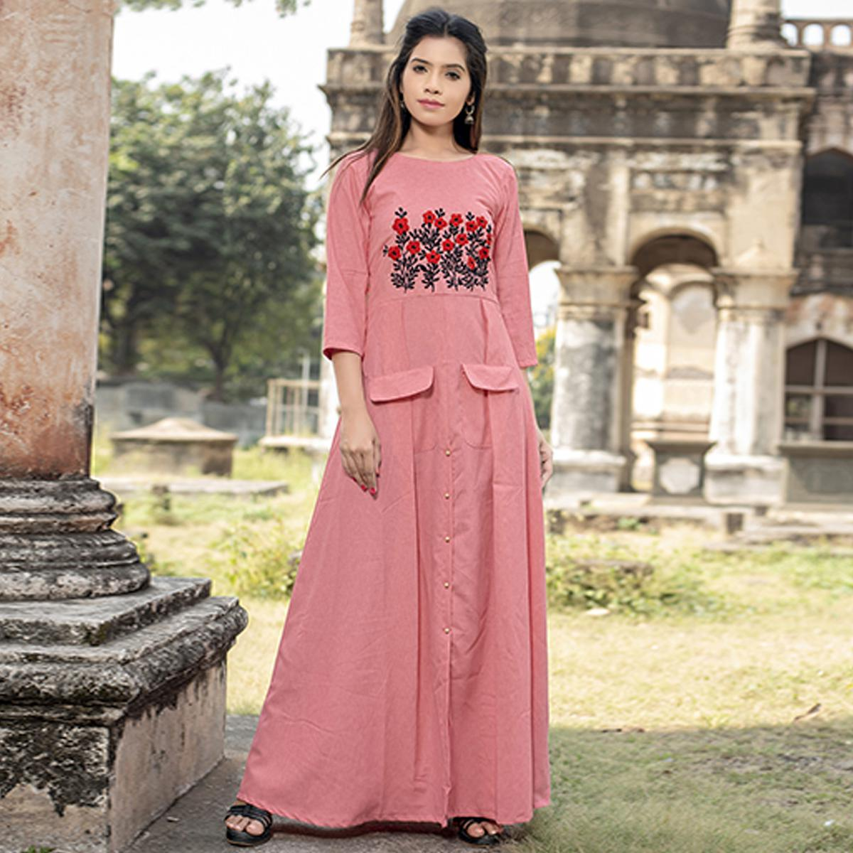 Mesmeric Pink Colored Partywear Embroidered Cotton Kurti