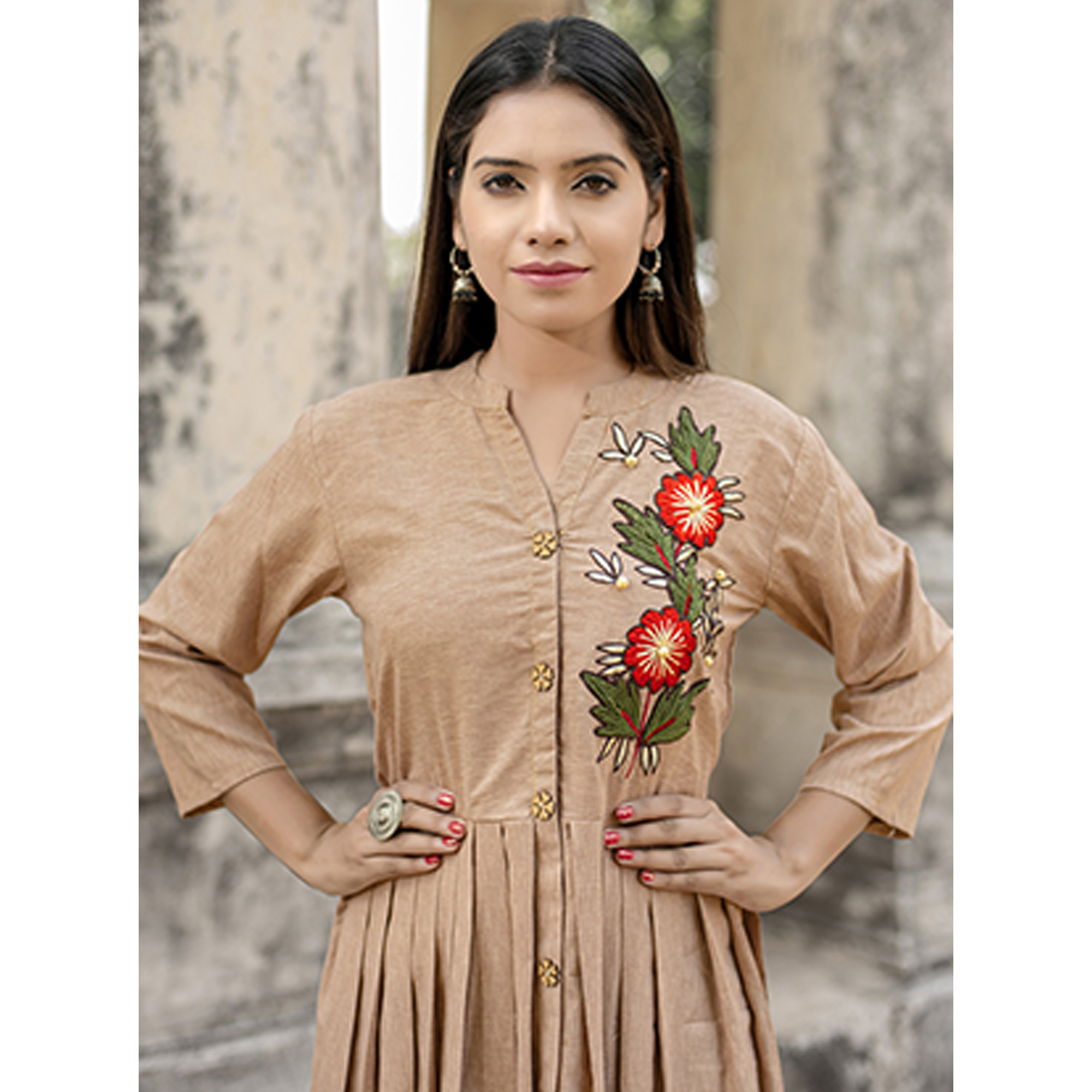 Trendy Beige Colored Partywear Embroidered Cotton Kurti